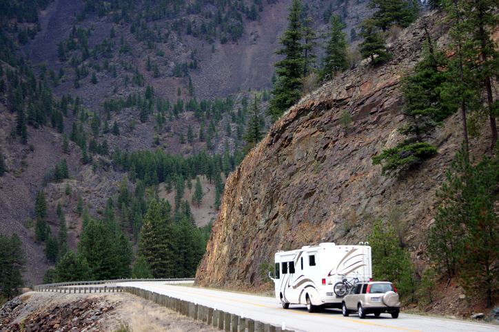 RV motorhome followed by SUV on a mountain highway