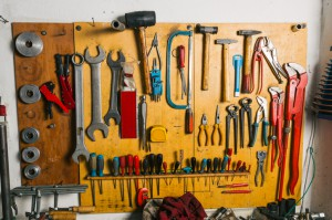 Tools Hanging On A Wall In Workshop
