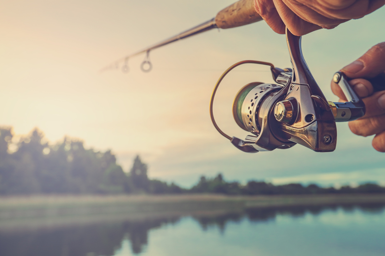 Fishing on the lake at sunset. Fishing background. - RV Lifestyle News, Tips, Tricks and More from RVUSA!