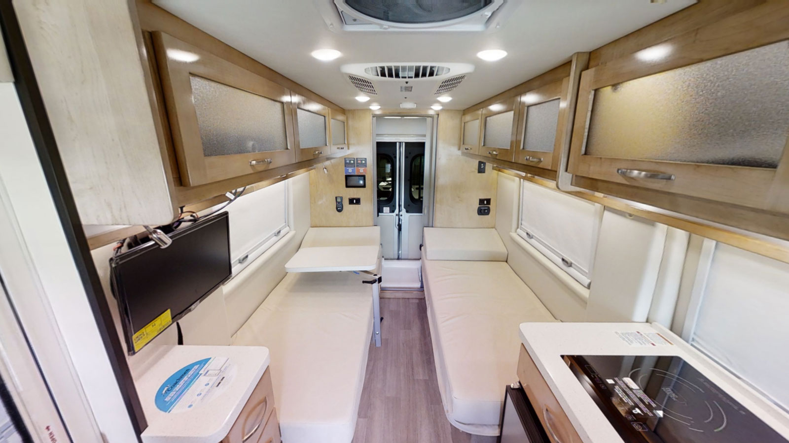 Best Class B RVs - interior of a Nova with two twin beds