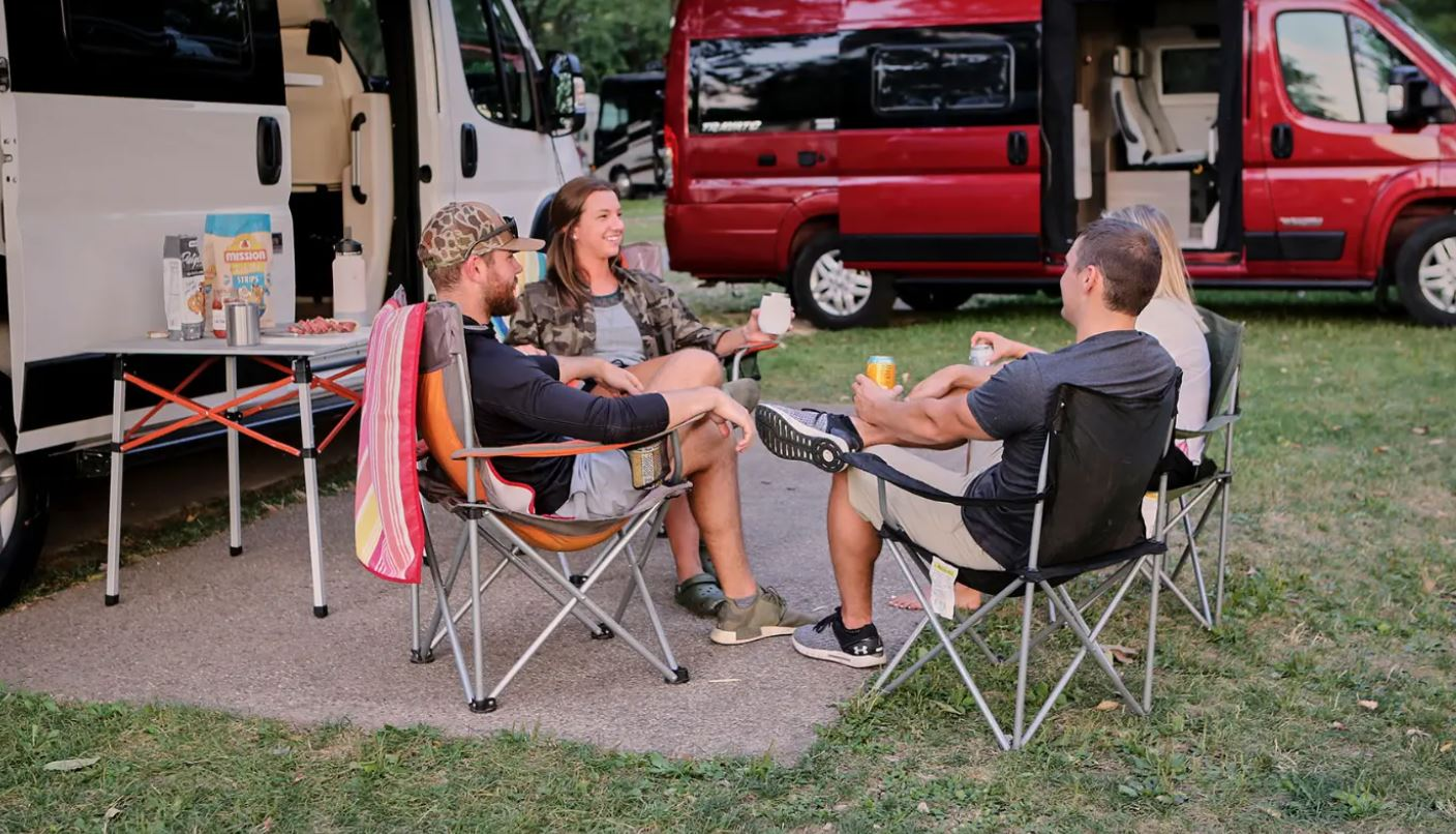 Best Class B RVs - people sitting in folding lawn chairs outside a Class B