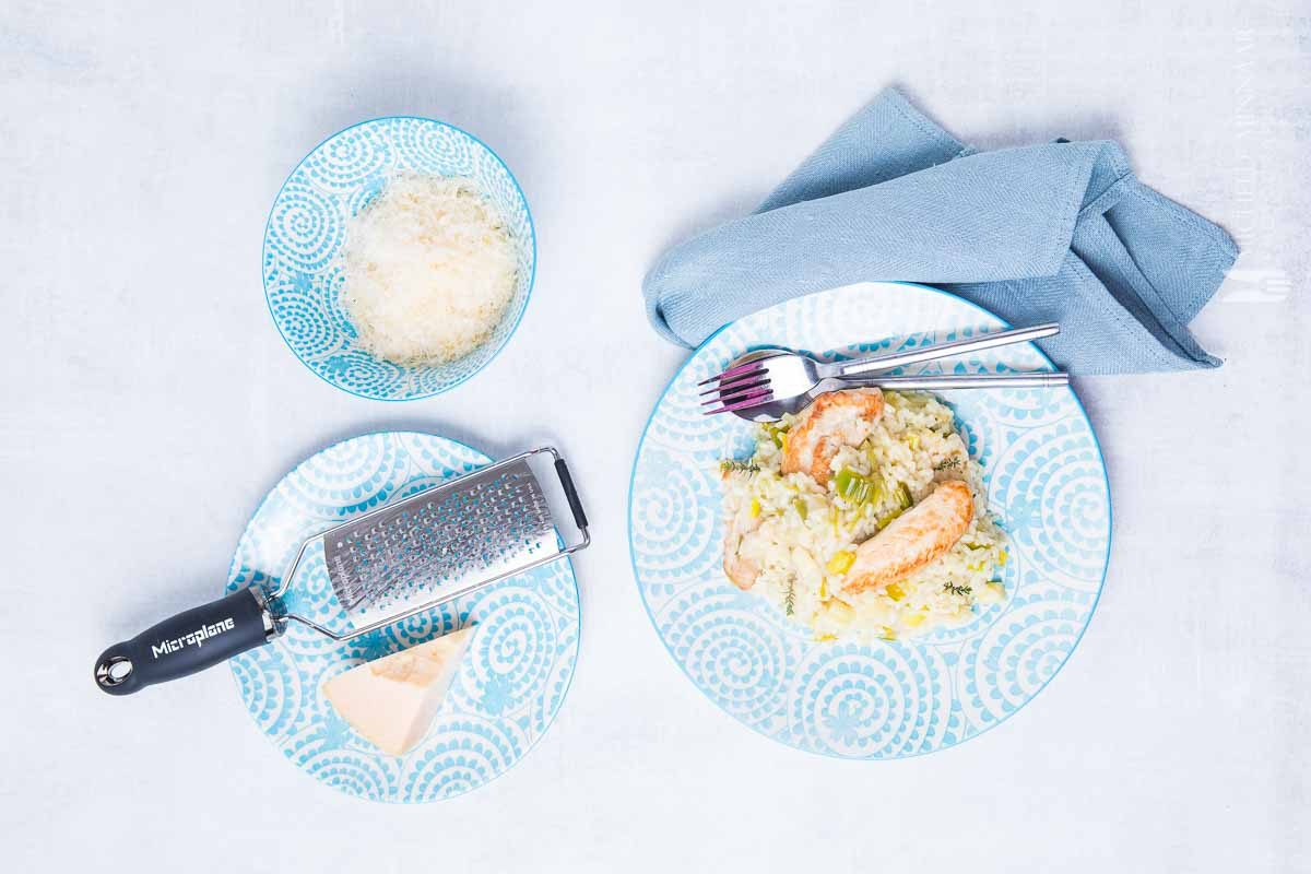 simple RV meal ideas - chicken risotto and grated cheese on blue dishes
