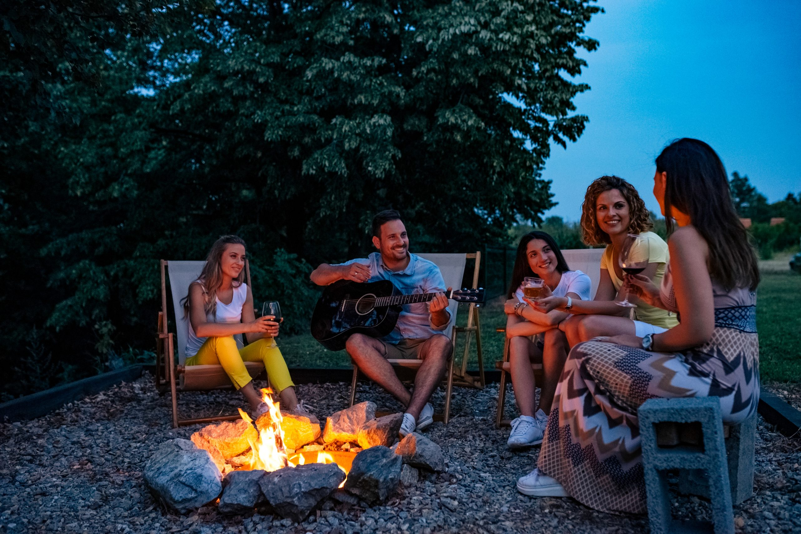tin foil pack campfire recipes - people sitting around campfire