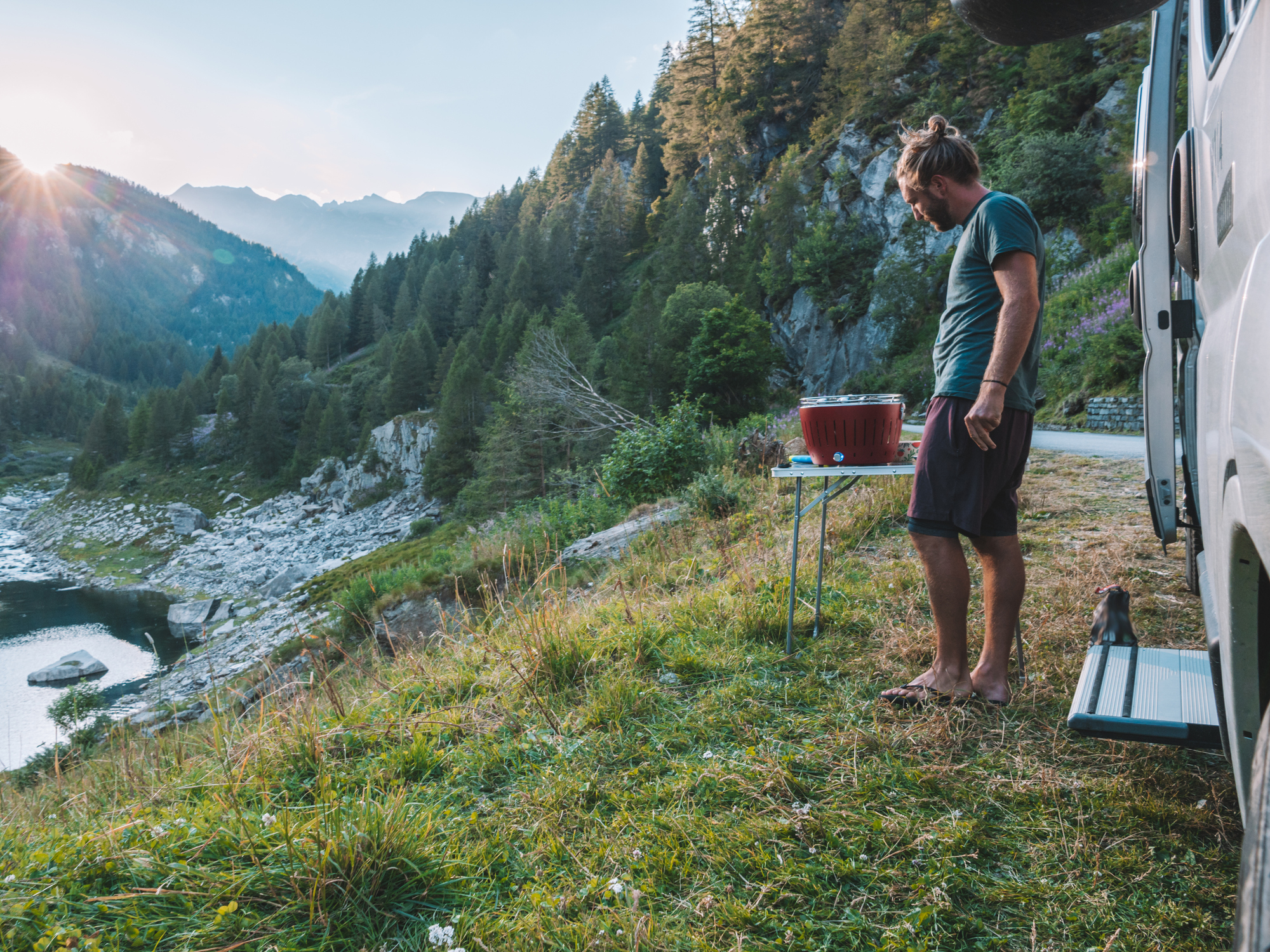 simple RV meal ideas - man grilling in the mountains