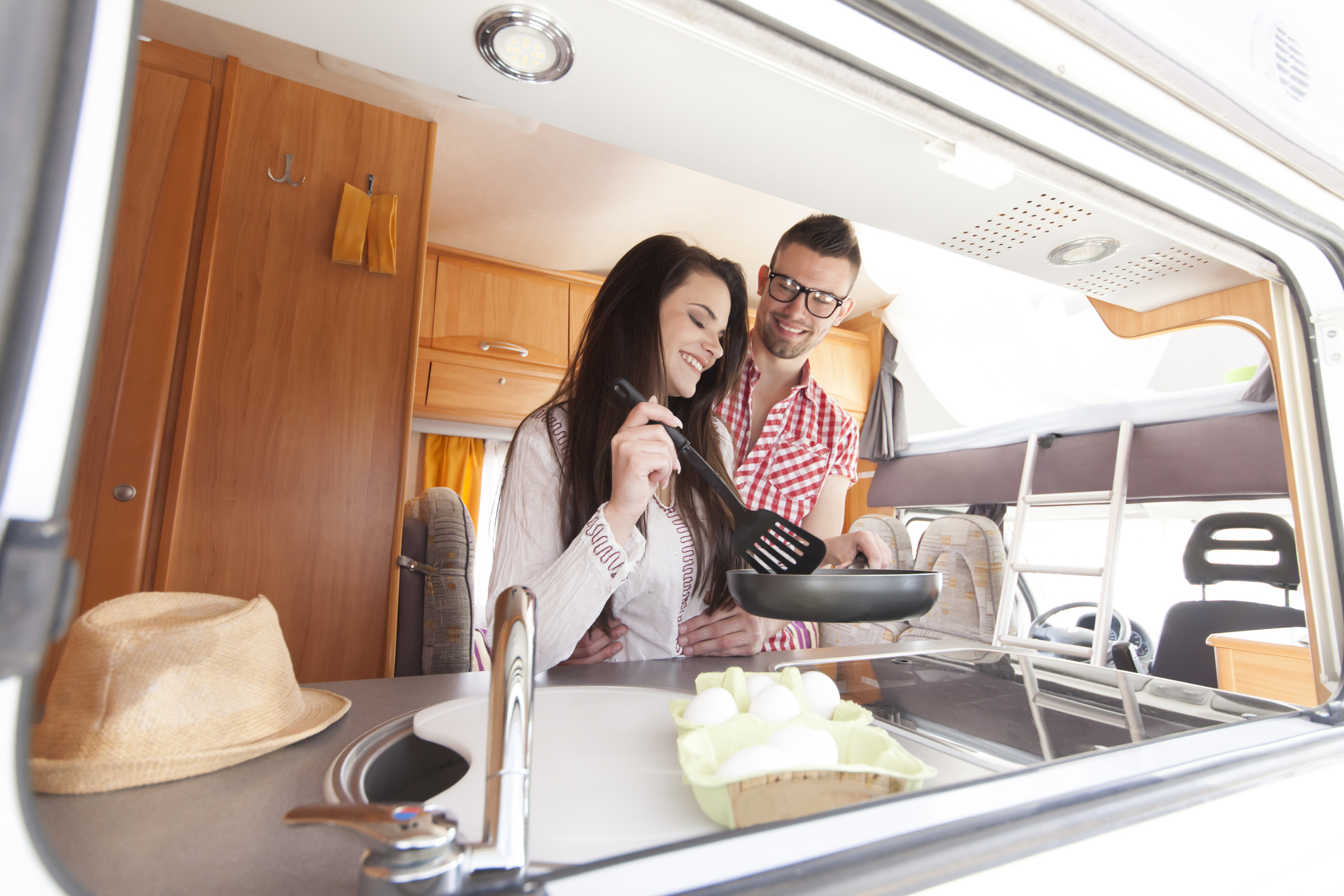 simple RV meals - couple cooking in an RV