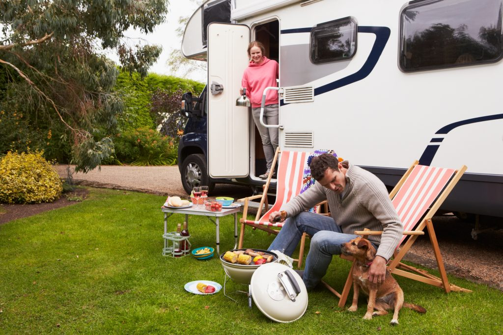 full-time RVing - couple grilling outside an RV