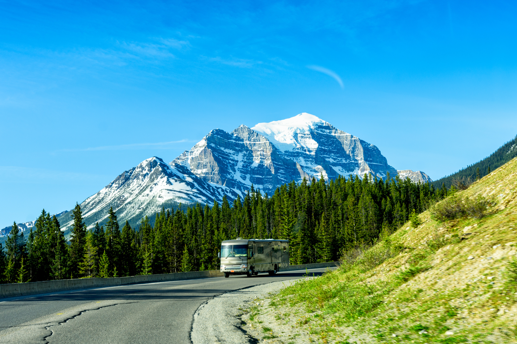 Class A RVs - motorhome driving past mountains