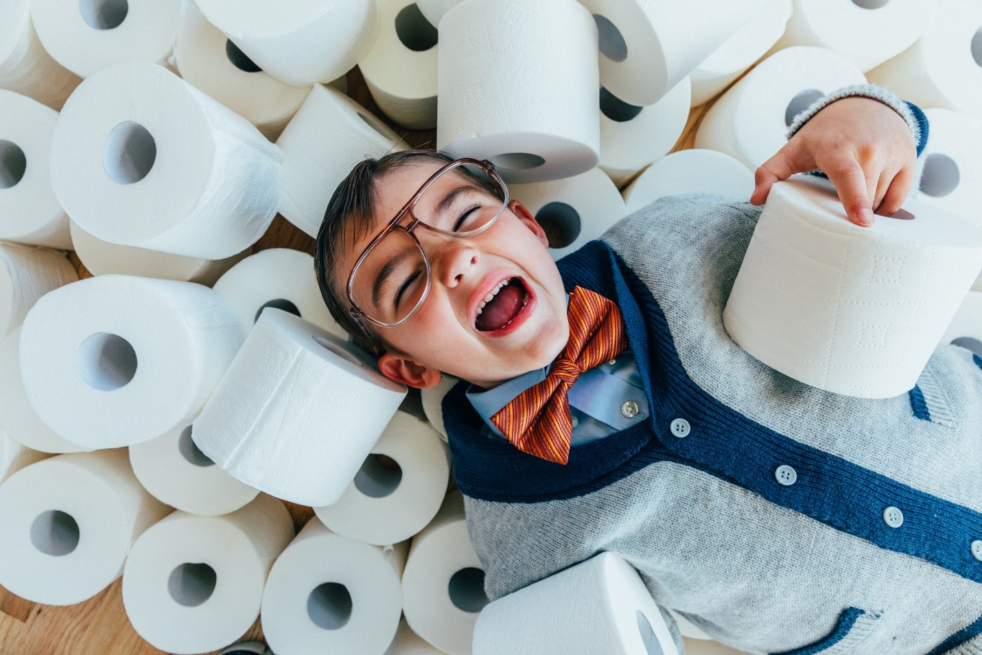 RV toilet paper - kid on pile of toilet paper